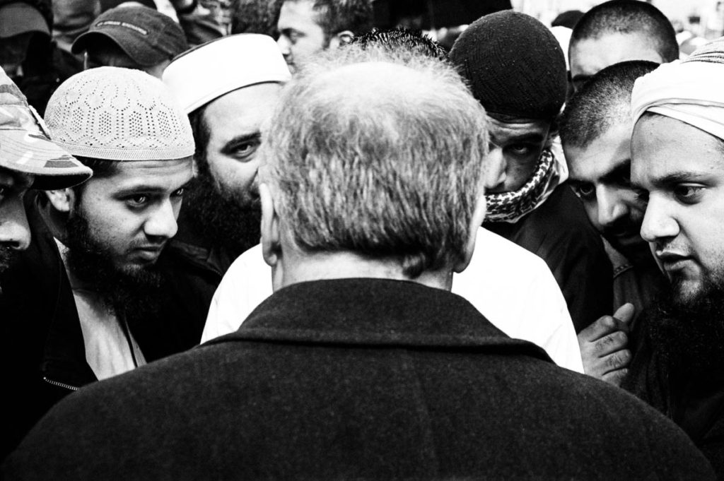 George Galloway, the then Member of Parliament (MP) for Bradford West, discusses the ongoing conflict in Iraq with a group of anti-war demonstrators in Trafalgar Square, London, UK. Image copyright © Thaddeus Pope, 2004.