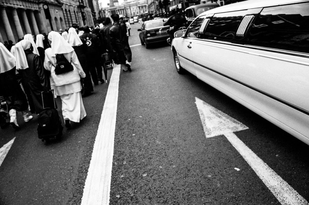 In a demonstration of solidarity between the two groups, Christian nuns and members of the Nation of Islam (NOI) march together down Whitehall during the 2004 Million Man March between Parliament Square and Trafalgar Square in London. Image copyright © Thaddeus Pope, 2004.